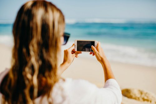 Influencer taking photo of the beach