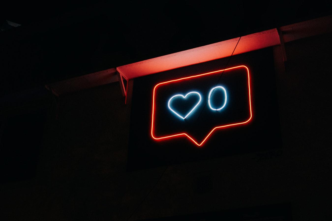 Neon post showing social media likes as zero
